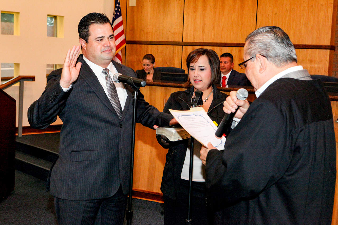 Mayor Pro Tem Homer Jasso, Jr., with his wife, Belinda, holding the Bible while his father, Precinct 4, Place 2 Justice of the Peace Homer Jasso, administers the oath of office