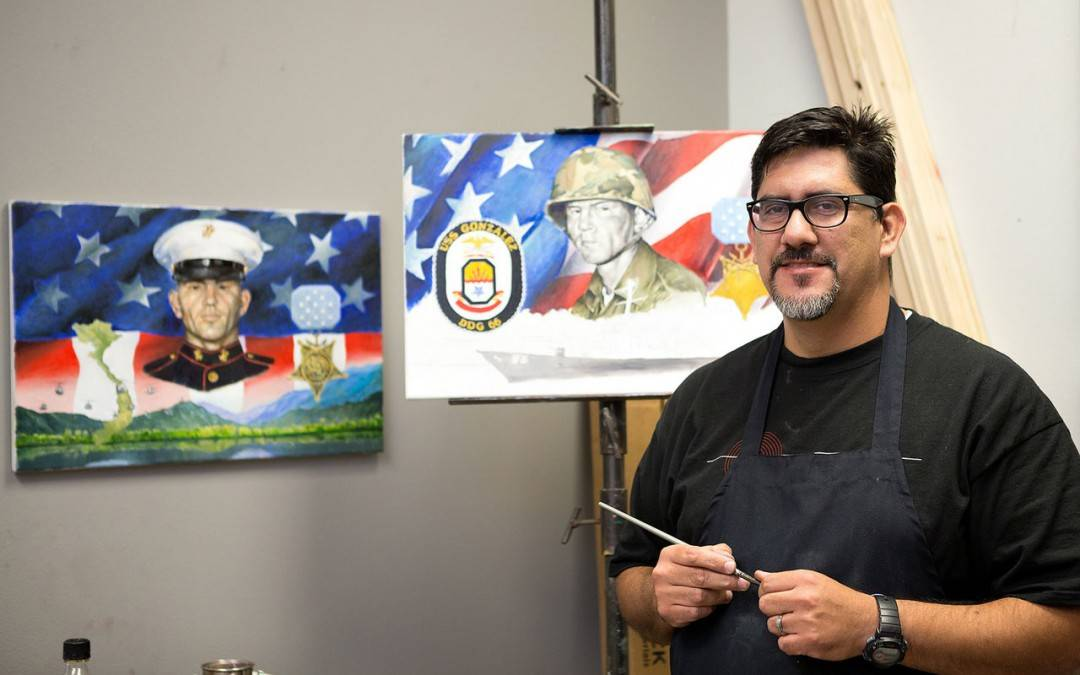 Ramiro Peña, UTRGV graduate art student, creating mural of Valley war hero Freddy González of Edinburg